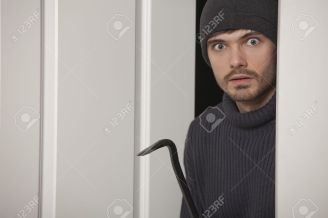 https://www.123rf.com/photo_8905474_burglar-with-crowbar-standing-surprised-in-the-door.html